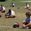 Gloucester: Gloucester sophomore Nick Taormina, right, stretches with the football team during their first day of practice yesterday. Photo by Kate Glass/Gloucester Daily Times Monday, August 24, 2009