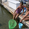 Essex: Chloe Bertocci, 8, and her sister, Sophia, 7, search for minnows and hermit crabs at Conomo Point yesterday afternoon. Photo by Kate Glass/Gloucester Daily Times Tuesday, August 18, 2009
