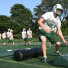 Manchester: Brian Ciccone, one of four captains of the Manchester Essex football team, leads agility drills yesterday afternoon. Photo by Kate Glass/Gloucester Daily Times Tuesday, August 25, 2009
