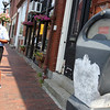 Gloucester: Erica Czolpinski writes a ticket for a car parked at an expired meter on Main Street yesterday. Gloucester has hired three meter maids to patrol the city after not having any during the month of July. Photo by Kate Glass/Gloucester Daily Times Monday August 17, 2009
