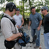 Gloucester: Andy Hillstrand of the Time Bandit, left, Dean Marsico of Indoors Out, center, and Jamie Marshall of Gloucester film a segment of the show Indoors Out as they redo Jamie's backyard. Photo by Kate Glass/Gloucester Daily Times Tuesday, August 4, 2009
