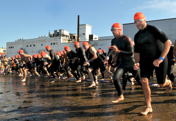 Gloucester: Joe Borge, 2nd from left, heads to the water for the 1st Gloucester Triathlon held Sunday morning on Pavilion Beach. Photo by Desi Smith/Gloucester Daily Times