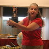 Anita Sanchez shows the listeners at the Rockport Library an example of a lantern that might have been used in 1814 during the time in which her book, The Invasion of Sandy Bay, takes place. Sanchez showed many various historical items that helped her with the process of writing her historical fiction book. Photo by Maria Uminski/ Gloucester Daily Times