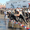 The horn sounds as the elite racers run into the water at Pavillion Beach just before 9 a.m. Sunday morning. Seven more divisions would follow. Photo by Jeff Pope/Gloucester Daily Times