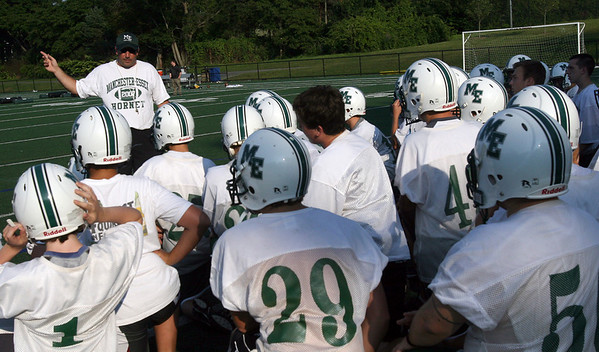 Manchester: Manchester Essex football coach Mike Athanas reviews the rules for practice at Coach Ed Field Field yesterday afternoon. Photo by Kate Glass/Gloucester Daily Times Tuesday, August 25, 2009