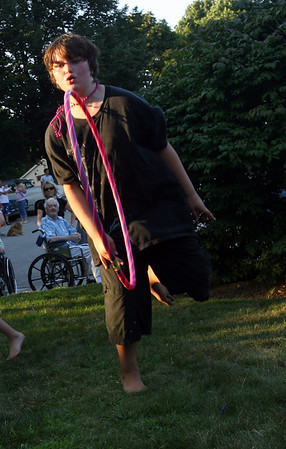 Rockport: Alexis Legere, 10, spins a hula hoop around while dancing to music at the Den-Mar Rehab and Nursing Center's annual antique car show on Tuesday evening. Photo by Kate Glass/Gloucester Daily Times Tuesday, August 18, 2009