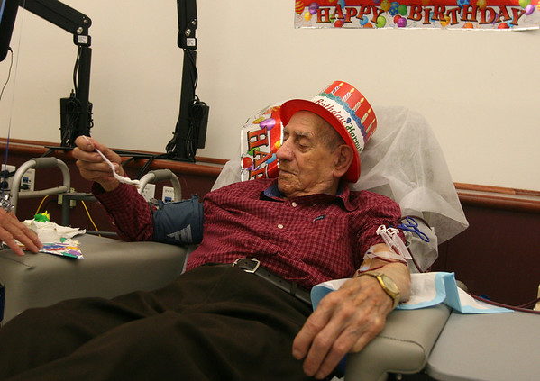 Beverly: Gaspar Palazola of Gloucester, enjoys a piece of birthday cake as he celebrates his 100th birthday at The North Shore Regional Dialysis Center yesterday afternoon. Palazola worked as a fisherman until he turned 70. Photo by Kate Glass/Gloucester Daily Times Wednesday, August 19, 2009