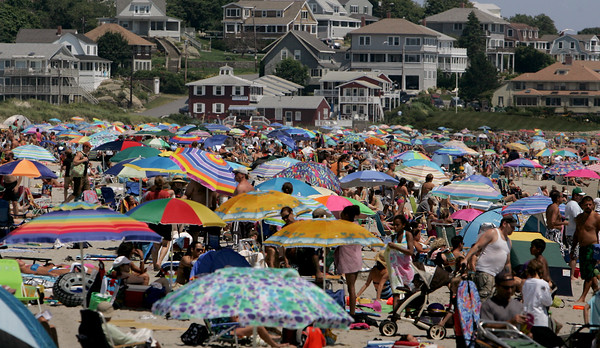 Gloucester: Hardly a space of sand can be seen as hundreds of people flocked to Good Harbor Beach with the parking lot filled to capacity by noon Saturday.  With low humidity ad plenty of sunshine Saturday was the perfect day to go to the beach. Mary Muckenhoupt/Gloucester Daily Times