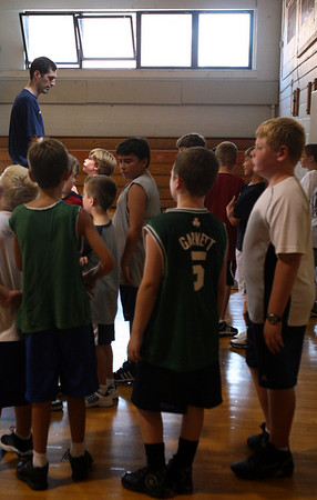 Rockport: Former NBA player Walter Palmer gives instructions to kids at the Rockport Basketball Clinic at Rockport High School yesterday morning. Photo by Kate Glass/Gloucester Daily Times Tuesday, August 18, 2009