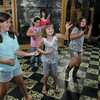 Gloucester: Students in Heidi Dalin's Gloucester Stage Youth Acting Workshop rock out as they play air guitar for an acting exercise during their last class at the Gloucester Stage Company Friday morning. From left is Jessica Muniz, Talia DeWolfe, Patrice Kelly, Madolin Beaulieu, front, Paige Harmon and Cara Buchanan. Mary Muckenhoupt/Gloucester Daily Times