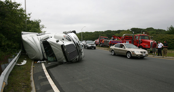 Gloucester: Vehicles from the Blackburn Industrial Park were periodically allowed to pass the scene of a tractor trailer rollover at Blackburn Circle yesterday afternoon. Route 128 was closed between Eastern Avenue and Grant Circle. Photo by Kate Glass/Gloucester Daily Times