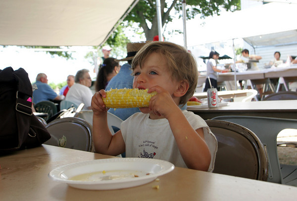 Rockport: Thomas Kerans, 3, of Rockport takes a big bite while eating his corn on the cob at the Rotary Club's Lobsterfest in front of the American Legion Hall by Back Beach Saturday afternoon. Proceeds from the event benefit local community service projects and the Rotary Club's scholarship fund. Photo by Mary Muckenhoupt/Gloucester Daily Times