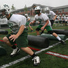 Manchester: Manchester Essex's Danny Oliver-Munn, left, and Austin Lyne run through obstacles during football practice at Hyland Field yesterday afternoon. Photo by Kate Glass/Gloucester Daily Times