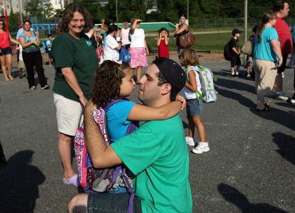 Gloucester: Joseph Frontiero kneels down to give his daughter, Emma Frontiero, a kiss as she starts her first day of kindergarten at Veterans Memorial School yesterday. Photo by Kate Glass/Gloucester Daily Times