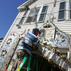 Gloucester: Gus MacIntosh, vice president of the Mother of grace Club, sets up all the outdoor decorations to get ready for the novena that begins Thursday for the 66th annual Mother of Grace Club Fiesta.  Mary Muckenhoupt/Gloucester Daily Times