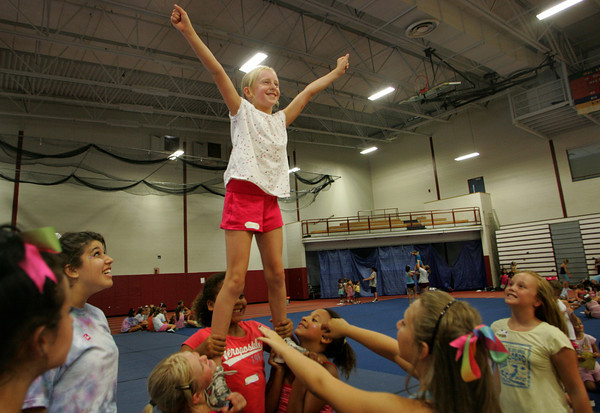 Gloucester: Madison Machado, 8, gets lifted in the air while practicing a mount during the Gloucester Cheeleaders' Mini Camp at Gloucester Field House Wednesday afternoon.  The cheerleading camp was held Tuesday through Thursday for children ages 5 to 13 with cheers taught by Gloucester High School cheerleaders. Mary Muckenhoupt/Gloucester Daily Times