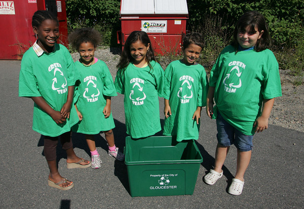 "Gloucester: From left, Tyla Ordonez, 9, Alexis Vivar, 7, Jasmyne Barani, 8, Josh Fuller, 8, and Raven Begeal, 8,  are children from the Pathways for Children Green Team to ensure that both staff and children are ""doing their share to keep the planet clean"". Thanks to Hiltz Disposal for donating their time and equipment to pick up Pathways recycling and to Gloucester's Market Basket for supplying paper bags. Mary Muckenhoupt/Gloucester Daily Times"