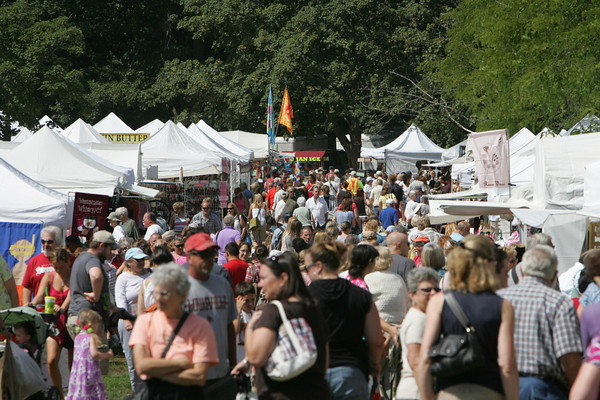 Gloucester: Hundreds of people mill about to check out the different crafts, food, and clothes that were sold at the Waterfront Festival Saturday afternoon at Stage Fort Park. Mary Muckenhoupt/Gloucester Daily Times