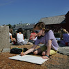 Rockport: Rhiannon Hurst, 7, of Rockport works on sketching out her harbor scene including Motif No. 1 at the end of T-wharf Wednesday afternoon.  Hurst was attending a week long water color class through the Rockport Art Association taught by Becky Merry.  Mary Muckenhoupt/Gloucester Daily Times