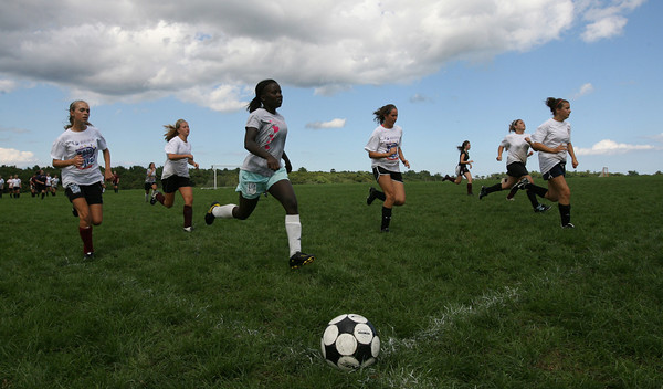 Gloucester: The Gloucester High School girls soccer team runs sprints at Magnolia Woods during practice yesterday. Photo by Kate Glass/Gloucester Daily Times