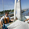 Essex: Easton Ehlers, 14, and Olivia Liberti, 14, raise the sails of a 420 sailboat before heading out for practice with the Essex Bay Sailing Club from Conomo Point Wednesday afternoon. Mary Muckenhoupt/Gloucester Daily Times