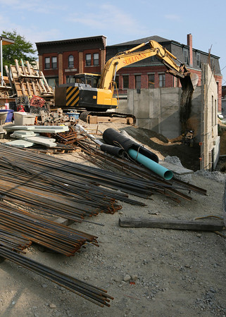 Gloucester: Workers build the foundation for the new apartment building on the site of the former Lorraine Apartments, which burnt down in 2007. Photo by Kate Glass/Gloucester Daily Times