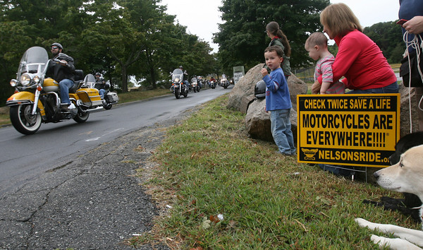 Gloucester: Ryan Church looks for his granfather among the motorcyclists taking part in Nelson's Ride, a motorcycle ride through Gloucester, Essex, Ipswich, Hamilton and Manchester in memory of Nelson Selig, who was killed in a motorcycle accident in May 2000. Standing with Ryan are his sister, Penelope Church, and grandmother, Chris Heinonen. Photo by Kate Glass/Gloucester Daily Times