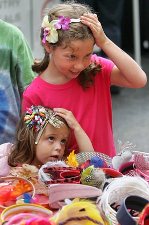 Gloucester: Lauren Alves, 8, and her sister Emma, 2, try on headbands at one of the tables on Main Street during Sidewalk Days Thursday afternoon. Sidewalk Days continues Friday and Saturday with vendors taking over the street. Thursday afternoon. Mary Muckenhoupt/Gloucester Daily Times