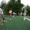 Manchester: Amy Fraser, left, works on a dribbling drill as Taylor Coons, right, waits her turn during Manchester Essex field hockey practice at Ed Field Field yesterday afternoon. Photo by Kate Glass/Gloucester Daily Times