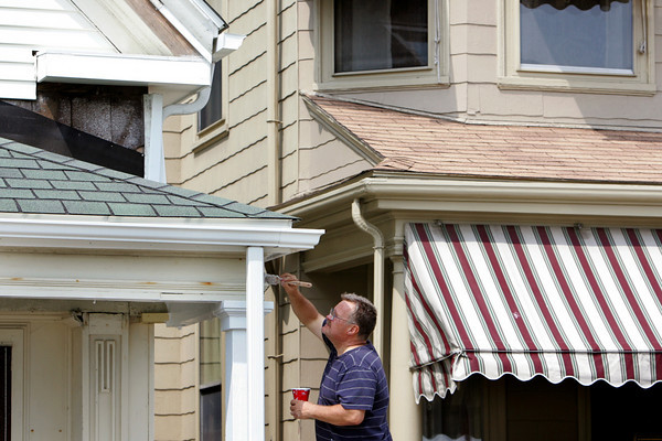Gloucester: Tom Weeks works on painting a side of a house on Stacy Boulevard Friday afternoon.  Mary Muckenhoupt/Gloucester Daily Times