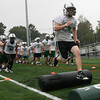 Manchester: Manchester Essex football captain Alex Carr runs through obstacles during practice at Hyland Field yesterday afternoon. Photo by Kate Glass/Gloucester Daily Times