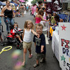 Gloucester: Alexiah Lingley, 4, and her friend Tristan Oliveira, 4, try and pop bubbles in front of the Gloucester High School Class of 2013 tent during Sidewalk Days held on Main Street Thursday afternoon. Mary Muckenhoupt/Gloucester Daily Times
