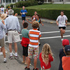 A small crowd gathers along Atlantic Road, near Moorland Road, to watch the runners in the Run Gloucester! 7-mile road race Sunday morning. Photo by Jeff Pope/Gloucester Daily Times