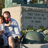 Gloucester: Salvatore Russo, 4, sits with his uncle Geoff Burbridge during the Fishermen's Memorial Service at the Man at the Wheel statue on Stacy Boulevard Saturday afternoon.  Salvatore was anxious to throw his flower into the ocean in honor of his father Matteo and grandfather John Orlando who were lost at sea aboard the Patriot in January 2009. Mary Muckenhoupt/Gloucester Daily Times