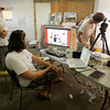 Gloucester: Chad Carlberg, director/producer, Emile Doucette, technical director and Sten Bowen, co-director, work on making a video for Guster in the old Birdseye building Friday afternoon. The painting of Gloucester artist Jon Sarkin was used throughout the video. Mary Muckenhoupt/Gloucester Daily Times
