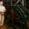 Essex: Brendhan Zubricki, Essex Town Administrator, says the town will be converting the clock at Town Hall to an automatic winding system though the current mechanics will remain in place. Currently, either Zubricki or Sally Soucy, the former town clerk, wind the clock once a week. Photo by Kate Glass/Gloucester Daily Times