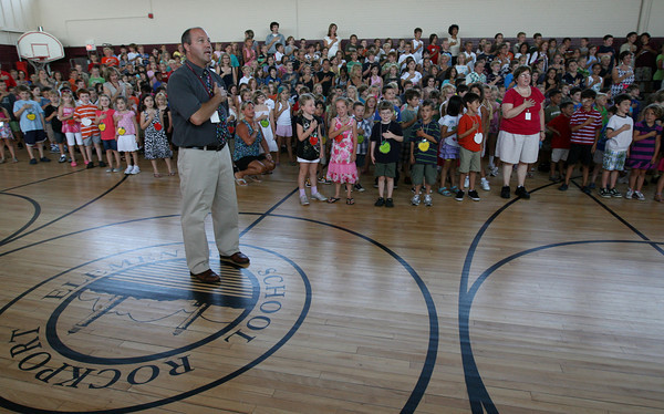 Rockport: Rockport Elementary School Principal Sean Maguire leads the Pledge of Allegiance during an assembly on the first day of school yesterday. Photo by Kate Glass/Gloucester Daily Times