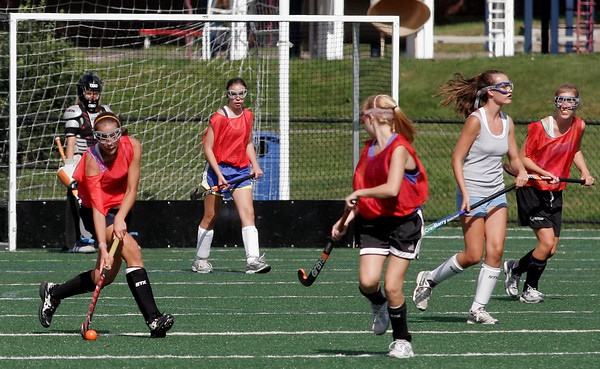 Manchester: Manchester Essex field hockey captain Kyle Marsh dribbles up the field during practice at Ed Field Field yesterday afternoon. Photo by Kate Glass/Gloucester Daily Times