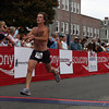 Gloucester: Matt Curran of Gloucester is the first Cape Ann resident to cross the finish line of the Run Gloucester! 7 mile road race yesterday morning. Curran finished with a time of 41:26. Photo by Kate Glass/Gloucester Daily Times