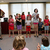 Rockport: Bob Kanegis sings about jumping on the bed as kids at the Rockport Public Library act out the song during the Summer Reading Program Wrap-Up Party yesterday afternoon. Photo by Kate Glass/Gloucester Daily Times