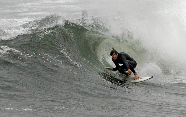 Rockport: A surfer emerges through a barrel wave at Cape Hedge Beach yesterday. Dozens of surfers flocked to the area to take advantage of the high surf caused by strong northeast winds. Photo by Kate Glass/Gloucester Daily Times