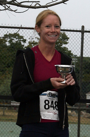 Gloucester: Layce Alves of Rockport holds the Connors Cup, which was presented to the top male and female finishers from Cape Ann. The cup is in memory of Austin Connors, who passed away earlier this year. Photo by Kate Glass/Gloucester Daily Times