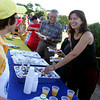 Gloucester:  Linda Burke of Gloucester chats with Rotarian Meredith Fine, left, as she gets her maple syrup at the Rotary benefit pancake breakfast at Stage Fort Park Saturday morning. The Rotary planned to sell 700 breakfast with proceeds going to Rose Baker Senior Center, North Shore Health Project and Senior Care Inc.. Mary Muckenhoupt/Gloucester Daily Times