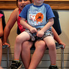"Rockport: Austin Story, 3, sits in the lap of his sister, Caitlyn Story, 6, as they listen to stories during ""Where the Green Things Are"" at the Rockport Public Library on Wednesday afternoon. Photo by Kate Glass/Gloucester Daily Times"