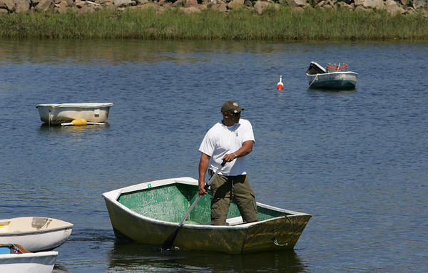 Manchester: Clay Rocker looks for a spot for his boat as he rows into to Manchester Harbor Saturday morning. Mary Muckenhoupt/Gloucester Daily Times