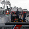 Gloucester: Members of the U.S. Coast Guard fold up a life raft after assisting in a rescue of a boat that sunk 3 miles off Gloucester yesterday. Photo by Kate Glass/Gloucester Daily Times