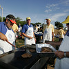 Gloucester: Gloucester Rotarians including, from left, Rick Doucette, Patrick Thorpe, Charlie Foster and Eric Noble get pancakes ready for the Rotary benefit pancake breakfast at Stage Fort Park Saturday morning. The Rotary planned to sell 700 breakfast with proceeds going to Rose Baker Senior Center, North Shore Health Project and Senior Care Inc.. Mary Muckenhoupt/Gloucester Daily Times