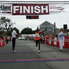 Gloucester: Alan Kiprono of Kenya is the first person to cross the finish line of Run Gloucester! yesterday morning with an official time of 32:54. Photo by Kate Glass/Gloucester Daily Times