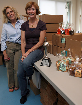 Essex: Mary Ann McCormick, front, co-owner of Lark Fine Foods in Essex, with Brenda Bronson, sales manager. The company recently won a sofi (specialty outstanding food innovation) award for their Chocolate Cha Cha cookies, which sell at several local specialty stores and are branching out across the country. Photo by Kate Glass/Gloucester Daily Times