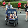 One runner pushed his children along the race course. Photo by Jeff Pope/Gloucester Daily Times